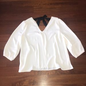 White Blouse with Black Tie